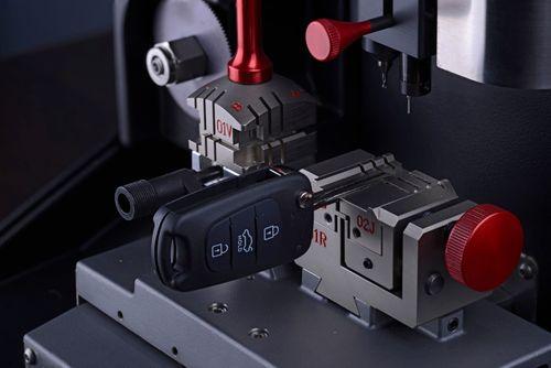 Forming new remote car keys in key cutting machine