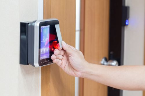 Holding key card up to modern electronic lock